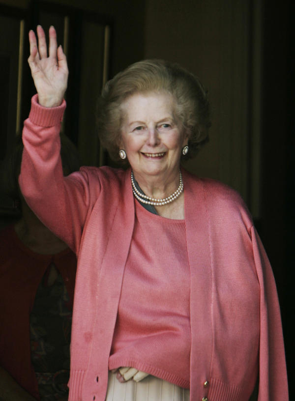 Thatcher waves to members of the media as she stands on her doorstep in London, following her return home from the hospital, June 29, 2009. Thatcher, suffering from dementia, had fallen and broken her left arm.