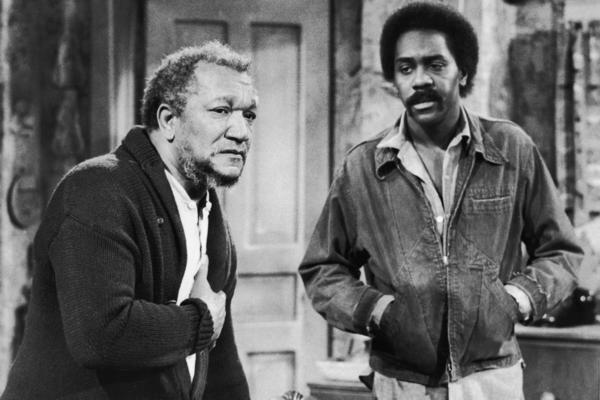 Redd Foxx (left) and Demond Wilson played the titular father-son duo in the TV show <em>Sanford and Son</em>, a Lear production that ran from 1972 to 1977.