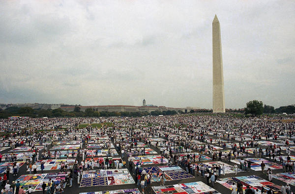 Thousands of people examine the individual panels of the AIDS Memorial Quilt as it is displayed in Washington in 1992.