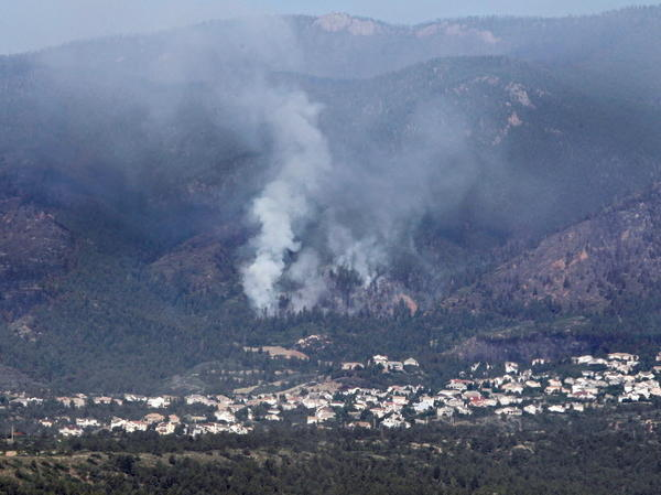 Smoke was rising earlier today from the Waldo Canyon wildfire that's threatening Colorado Springs, Colo.