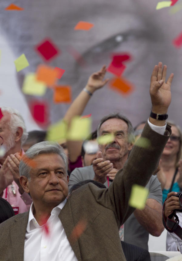 Andres Manuel Lopez Obrador, presidential candidate for the Democratic Revolution Party, waves at supporters during the closing rally of his campaign at the main Zocalo plaza in Mexico City on Wednesday.