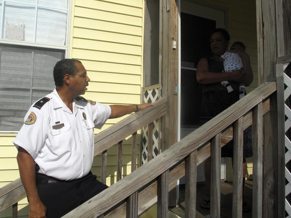 Third District Commander John Thomas urges residents the Gentilly neighborhood to help fight crime and drug violence.