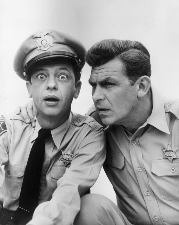 Don Knotts played bumbling Deputy Barney Fife to Griffith's Sheriff Andy Taylor on the sitcom <em>The Andy Griffith Show.</em>