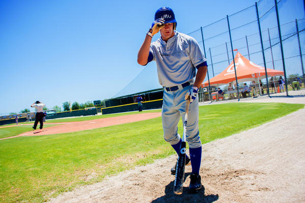 Ketchum Marsh, a senior from Massachusetts, walks back to the dugout during an intrasquad game at IMG Baseball Academy, where he trains and goes to school.