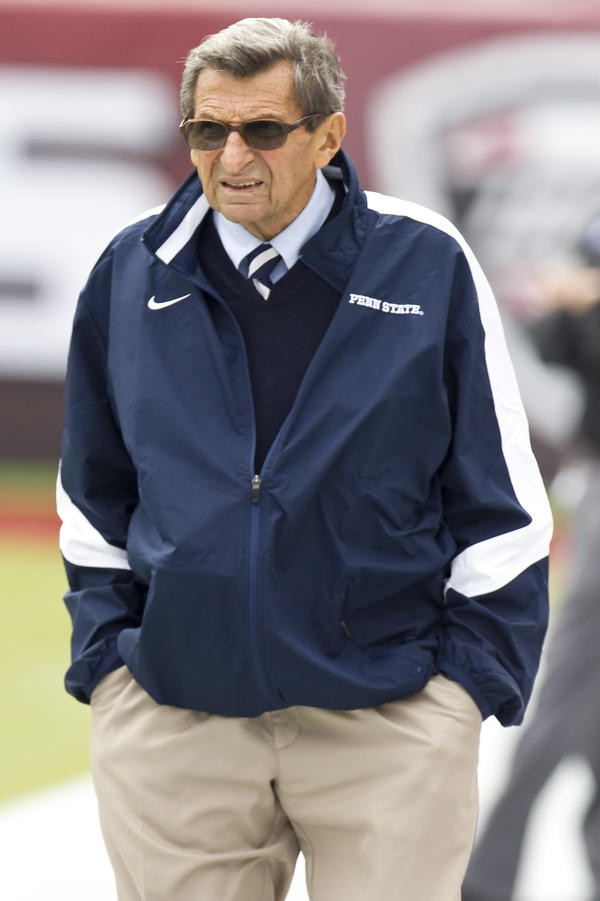 Joe Paterno walks the sidelines during warm-ups before a game between his Penn State Nittany Lions and the Temple Owls in Philadelphia last September. Paterno, who died in January, was fired on Nov. 9, four days after Jerry Sandusky was initially arrested on charges of sexually abusing 10 boys.
