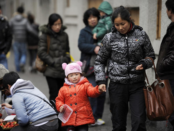 A mother and child walk in Shanghai. China's one-child policy has been in place since 1979. There's now a debate about whether the policy should be eased or dropped.