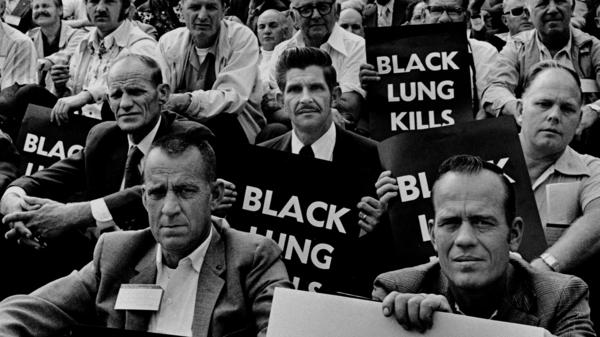 """Coal miners rally for black lung law reform on the steps of the U.S. Capitol in 1975. (See more from Earl Dotter's """"Quiet Sickness"""" series <a href=""""http://www.npr.org/blogs/pictureshow/2012/07/09/156386882/documenting-dirty-jobs-miners-at-work"""">here</a>.)"""