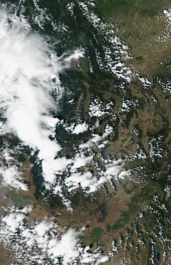 The view from above: A satellite image of Idaho and western Montana, taken Monday and posted by the USDA Forest Services's Active Fire Mapping website, showing smoke and clouds.