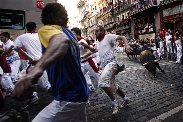 The San Fermin Festival, with its famed running of the bulls, is always a huge fiesta but seasoned locals say the celebrations were a bit muted this year because of Spain's dismal economy.