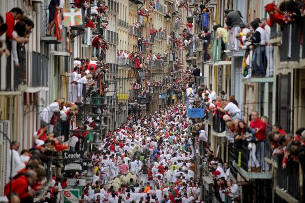 Some revelers drawn to the festival are Ernest Hemingway fans, enchanted by <em>The Sun Also Rises</em>, his 1926 novel that popularized Pamplona's signature fiesta.