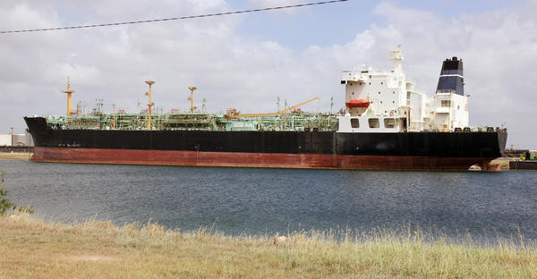 A tanker ship waits to be recycled. Even ships that appear to be in good working condition are valuable as scrap metal.