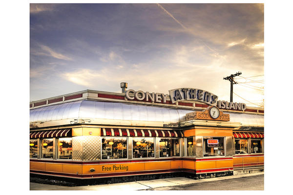 Athens Coney Island  is on Woodward Avenue, which boasted the first mile of paved concrete roads in the United States; today it is home to about a dozen Coney Island restaurants.