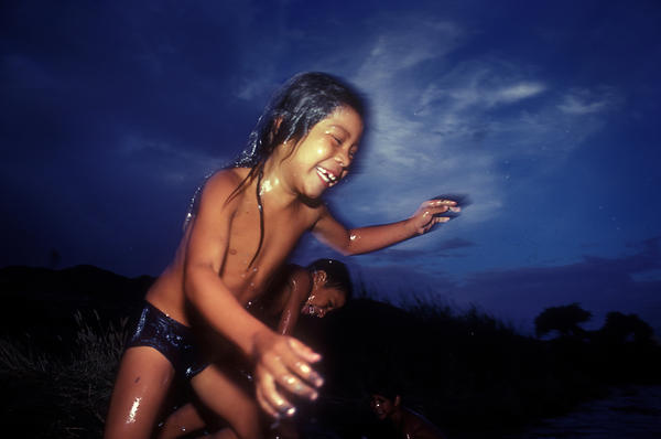<em>River Jump in the River with Two Names,</em> 1989. Kids cool off in the river with two names — Rio Grande on the U.S. side, and Rio Bravo in Mexico.