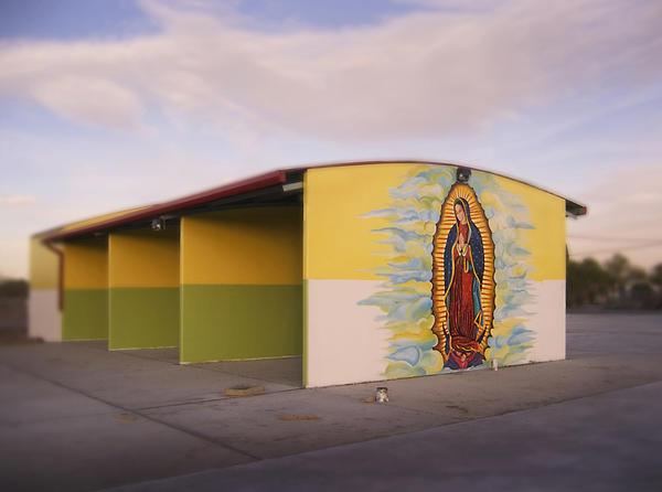 <em>The Virgin's Car Wash,</em> 2005. The Virgin de Guadalupe on an unfinished car wash in El Paso.