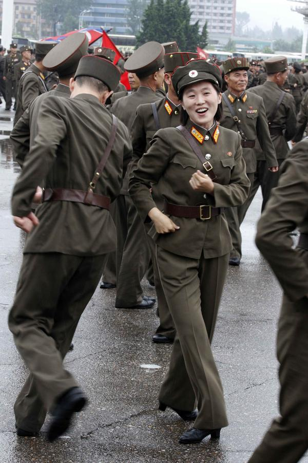 North Korean soldiers dance in the plazas of Pyongyang on Wednesday after the country announced that leader Kim Jong Un was granted the title of marshal.