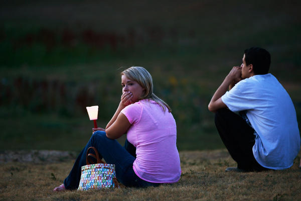 Mourners also held a candelight vigil in Devner, Colo., Friday.