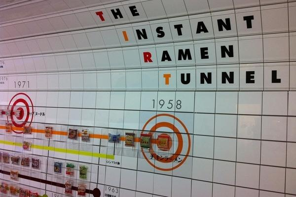 A tunnel timeline showcasing the history of instant ramen at the Momofuku Ando Instant Ramen Museum in Osaka, Japan.