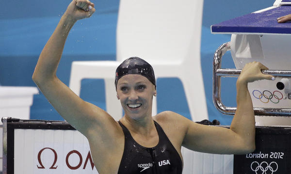 American Dana Vollmer celebrates after her gold medal win Sunday in the women's 100-meter butterfly swimming final at the Aquatics Centre in the Olympic Park.