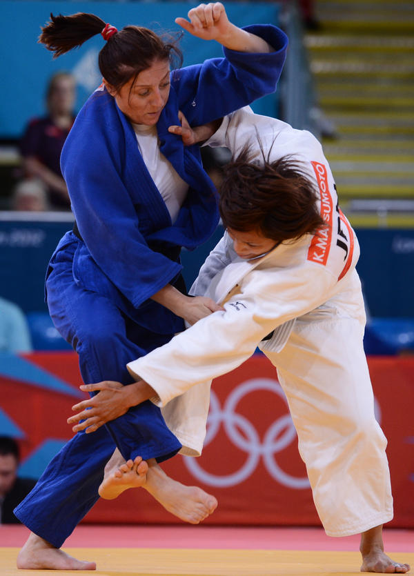 Japan's Kaori Matsumoto (white) competes with Romania's Corina Caprioriu during the women's 57kg judo finals. Matsumoto won the match.