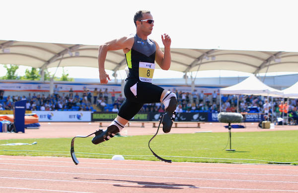 "Oscar Pistorius of South Africa runs in the men's 200-meter event at the Paralympic World Cup in May. Some observers have suggested Pistorius receives an unfair advantage from his carbon-fiber ""blade"" legs."