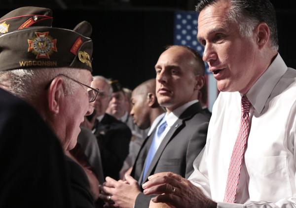 Republican presidential candidate Mitt Romney meets with members of the Veterans of Foreign Wars after his speech at the VFW National Convention in Reno, Nev., on July 24.
