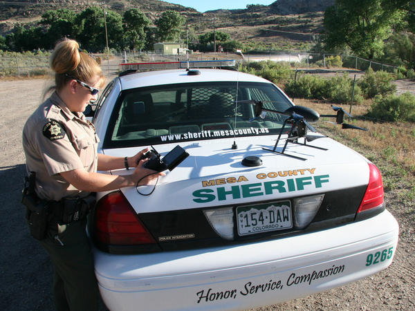 Deputy Amanda Hill of the Mesa County Sheriff's Office in western Colorado prepares to use a Draganflyer X6 drone equipped with a video camera to help search for a suspect in a knife attack in this undated photo.