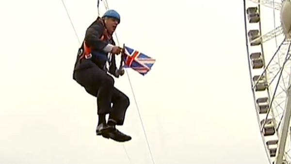 A still image taken from an eyewitness video shows London's Mayor Boris Johnson hanging from a zipline, after losing his momentum.