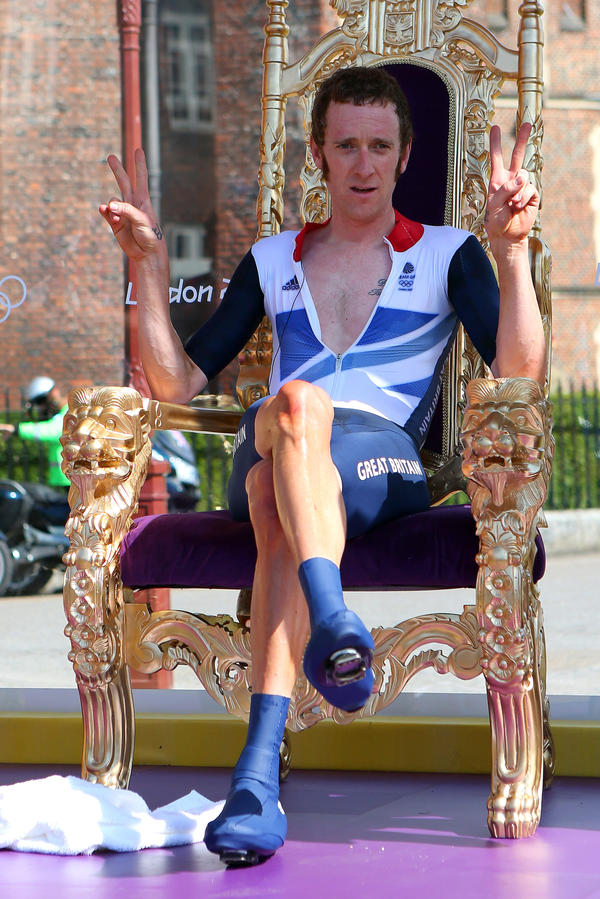 "<strong>The Mods' New King?</strong> Cyclist Bradley Wiggins sits on a chair that looks an awful lot like a throne, after winning an Olympic gold medal Wednesday. Hailed in Britain for his mod tastes and funny tweets, Wiggins celebrated his win by getting ""blind drunk,"" he said."
