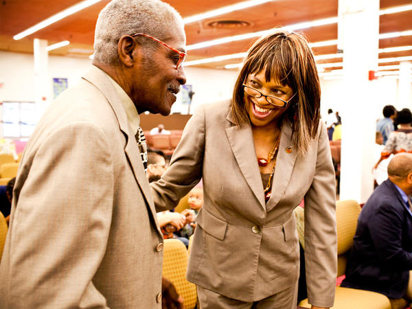 Natasha Shamone-Gilmore smiles at her father Franklin Brunson, 81, during a Sunday church service in Capitol Heights, Md. She has taken on the daily challenge of caring for her father, who is suffering from mild dementia.