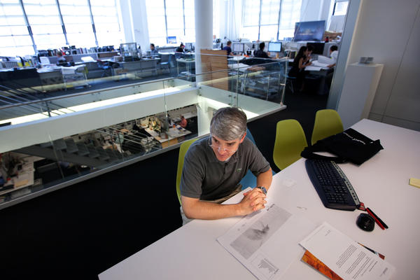 Guy Maxwell, principal at Ennead Architects, talks to a reporter in the firm's Manhattan offices.