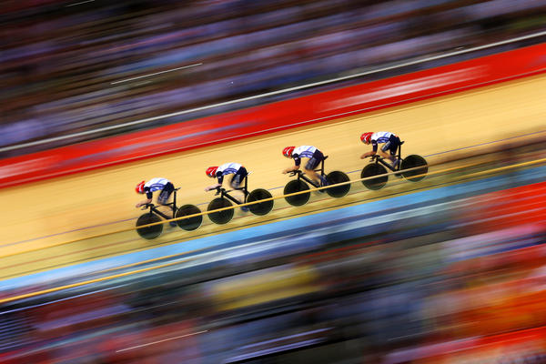 Great Britain posts a new world record time during Men's Team Pursuit Track Cycling Qualifying event.