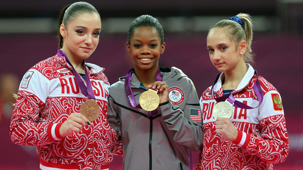 "<strong>Who's The Happiest?</strong> Researchers studied photos of Olympic medalists to learn who is the happiest. Here, bronze medalist Aliya Mustafina of Russia, gold medalist Gabby Douglas of the U.S., and silver medalist Victoria Komova of Russia pose after the <a href=""http://www.npr.org/blogs/thetorch/2012/08/02/157797366"">all-around gymnastics final</a>."