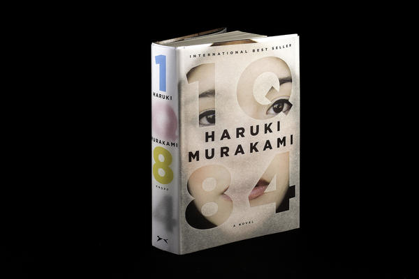 """<strong><em>1Q84</em></strong><strong> by Haruki Murakami</strong>: """"This epic, complex story begins when a woman named Aomame in 1984 Tokyo has a revelation that she has entered a universe parallel to our own. She calls it 'Q' for question, and in Japanese, Q rhymes with 9. I wanted to represent these two planes of existence with the book's jacket and its paper binding underneath."""""""
