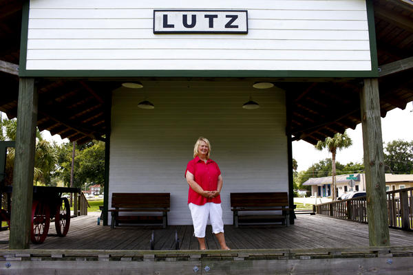 <strong>Faces of Florida's First and Main: </strong>Susan MacManus lives in her family's home on a secluded plot of land near Lutz, Fla. MacManus, shown at the old train depot across from the public library, is a political scientist and local historian. Her family was among the first to develop land around here a century ago.