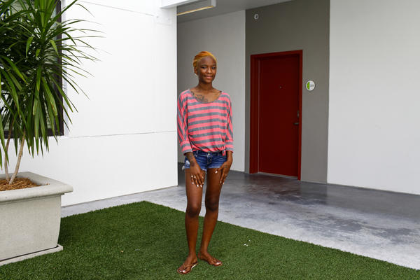 """Jayla Mills, 18, lives in the Metro 510 apartment complex that was funded with stimulus money in downtown Tampa. She entered the foster care system at 15 and recently aged out but is fighting for custody of her special needs daughter, Promise. """"Do I need the president in this courtroom? Who do I need next to me? Because right now, I have nobody."""" Mills is undecided about who to vote for this fall."""