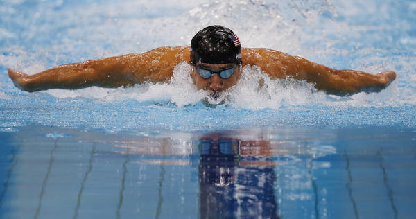 Michael Phelps competes in the men's 100m butterfly final. Phelps surged from behind to win the event.