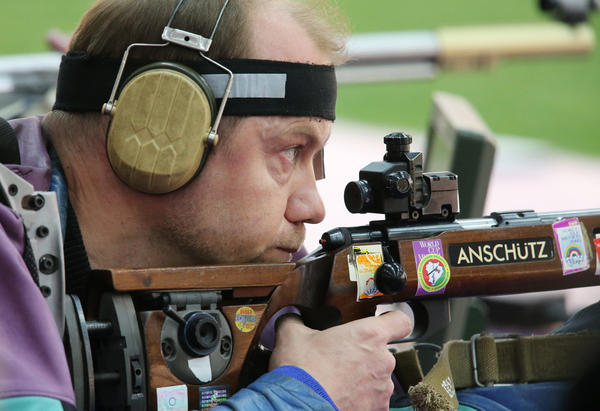 Sergei Martynov of Belarus competes in the men's 50m rifle prone shooting event. Martynov won the event.