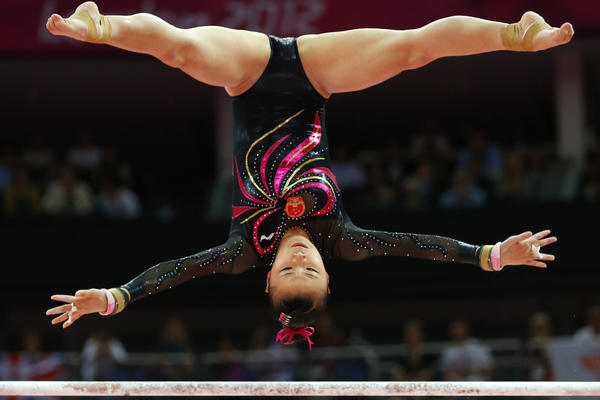 Gymnast He Kexin of China competes in the uneven bars final. She placed second in the event.