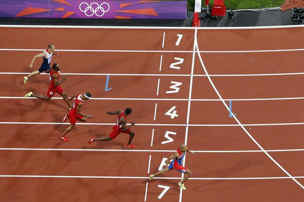 Felix Sanchez of the Dominican Republic wins gold ahead of U.S. hurdler Michael Tinsley and Puerto Rico's Javier Culson in the men's 400-meter hurdles final.