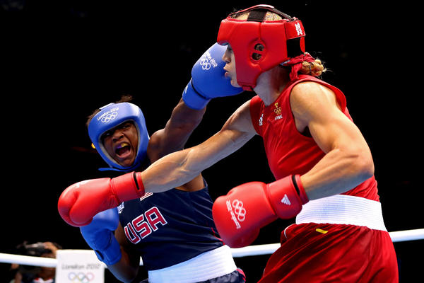 U.S. boxer Claressa Shields (in blue) competes against Sweden's Anna Laurell during the women's middleweight boxing quarterfinals. Shields won the bout and will move on to the semifinal round.
