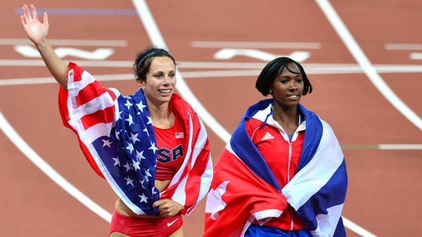 American gold medalist Jenn Suhr and Cuba's silver medalist Yarisley Silva celebrate after the women's pole vault final at the London 2012 Olympics. Suhr won silver at the 2008 Games.
