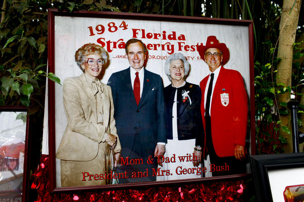 """The Meeks display a large photo of themselves posing with George and Barbara Bush in 1984. The market has become a """"must-visit"""" destination for presidential candidates."""