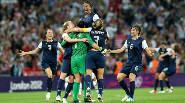 Hope Solo (in green), Shannon Boxx (top), Christie Rampone, Amy LePeilbet (right), and Kelley O'Hara (left) celebrate the U.S. women's soccer team's gold medal, after defeating Japan, 2-1, in London.