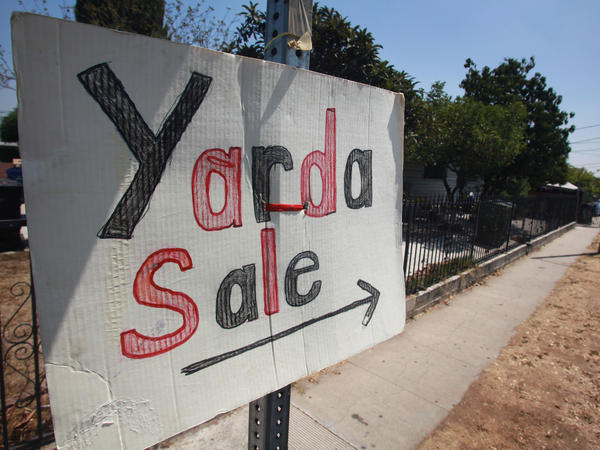 Spanglish, a mixture of English and Spanish, has been spoken for more than a century. A sign in Spanglish advertises a yard sale in Los Angeles in 2009.
