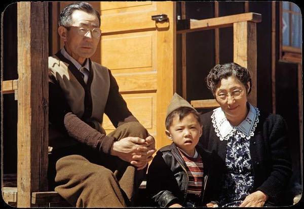 Billy Manbo sits with his maternal grandparents, Junzo (left) and Riyo Itaya.