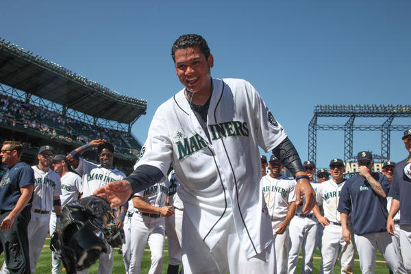 Starting pitcher Felix Hernandez of the Seattle Mariners was dowsed with water after throwing a perfect game against the Tampa Bay Rays at Safeco Field in Seattle.
