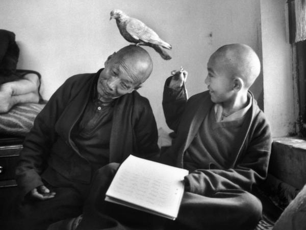 Tulku Khentrul Lodro Rabsel, 12, is pictured with his tutor Lhagyel at the Shechen Monastery in Bodnath, Nepal. Kehntrul entered the monastery at the age of 5, and like other young monks was restricted from seeing other monks of his age. Martine Franck took this photo in 1996.