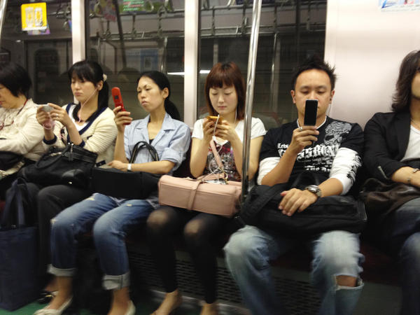 Passengers on the Tokyo subway can regularly be found glued to their mobile devices.