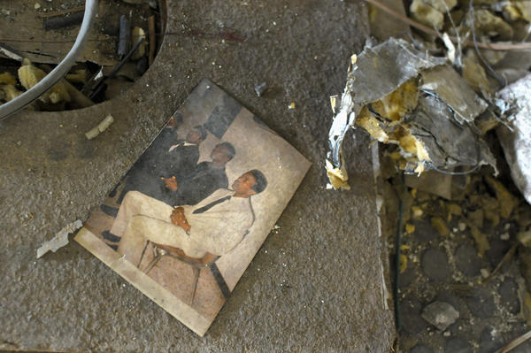 A photograph lies amid the rubble.