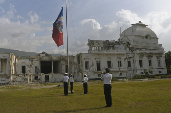 Members of the Haitian Color Guard lower the flag in front of the National Palace on Aug. 9.